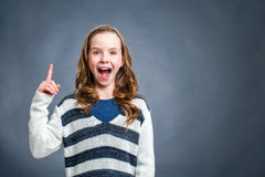 Cute girl with surprising expression against dark background. Royalty Free Stock Images