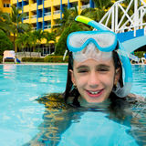 Cute girl on a swimming pool. Child wearing a diving mask on a swimming pool and smiling Royalty Free Stock Photos