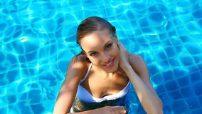 Cute girl in swimming pool Royalty Free Stock Photography