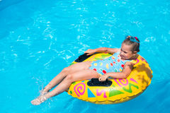 Cute girl in a swimming pool Stock Image