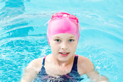 Cute girl in swimming pool Royalty Free Stock Photo