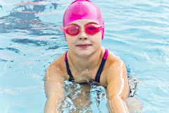 Cute girl in swimming pool Stock Photography