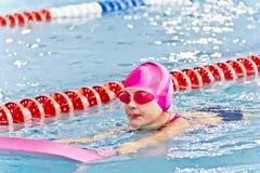 Cute girl in swimming pool Stock Image