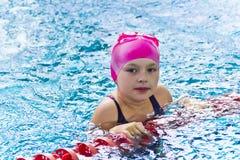 Cute girl in swimming pool Stock Photos