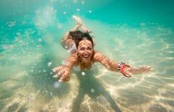 Cute Girl Swimming Under Sea royalty free stock photo