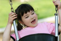 Cute girl swinging royalty free stock photos