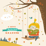 Cute girl swinging and reading a book in autumn park Royalty Free Stock Photo