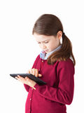 Cute Girl and tablet Royalty Free Stock Photography