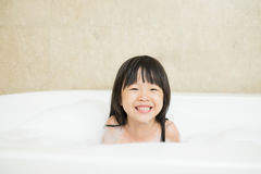 Cute girl take bath Stock Images
