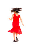 Cute girl taking an action turn, isolated on white Royalty Free Stock Photo