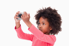 Cute girl taking a picture Royalty Free Stock Photography