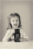 Cute girl taking pictures Royalty Free Stock Photography