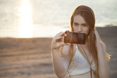 Cute girl taking selfie on the beach Royalty Free Stock Photos