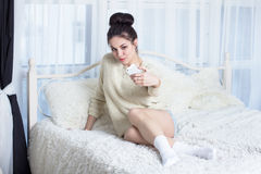 Cute girl taking selfie on the bed Stock Photography