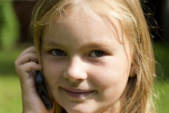 Cute girl talking by cellular Stock Photo