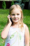 Cute girl talking by cellular Royalty Free Stock Image