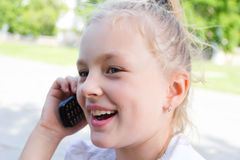 Cute girl talking by cellular Royalty Free Stock Photo
