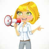 Cute girl  talking into a megaphone  and shows her Royalty Free Stock Image