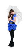 Cute girl  talking by mobile phone under sunny umbrella Royalty Free Stock Image