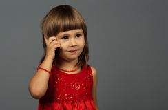 Cute girl talking on the phone Royalty Free Stock Images