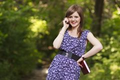 Cute girl talking on the phone Royalty Free Stock Photos