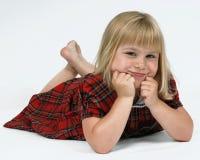 Cute girl in tartan dress Stock Photography