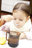 Cute girl with tea. Little cute girl drinking a cup of hot tea Royalty Free Stock Photography