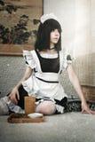 Cute girl maid. Cute girl with tea dressed as a maid stock photos