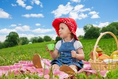 Cute girl in ted hat drinking Stock Images