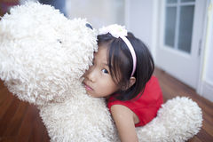 Cute girl with teddy bear Stock Image