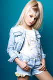 Cute girl teenage with long blond hair posing studio nature portrait. Stock Photography