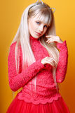 Cute girl teenage with long blond hair posing studio nature portrait. Royalty Free Stock Image