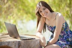 Cute girl telecommuting Stock Image