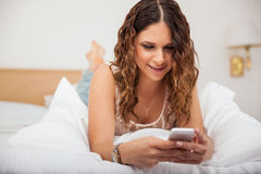 Cute girl texting at home Stock Photo