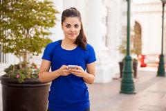 Cute girl texting on a phone Stock Images