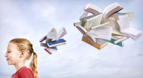 Cute girl thinking about books Stock Photo