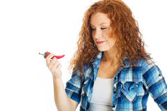 Cute girl thinking about a hot red pepper Stock Image