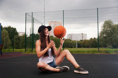 Cute Girl Throw Basketball Royalty Free Stock Photos