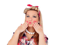 Cute girl throwing a kiss in pinup style Royalty Free Stock Images