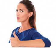 Cute girl with thumb up gesturing great job Royalty Free Stock Photography