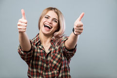 Cute girl with thumbs up Stock Photos