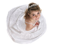 Cute girl in tiara and white formal gown Stock Images