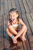 Cute girl on a timber floor Stock Photo
