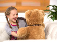 Cute girl with toy bear. Royalty Free Stock Image