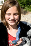 Cute Girl With Toy Snake Stock Photo