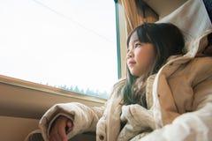 Cute girl on train Stock Image