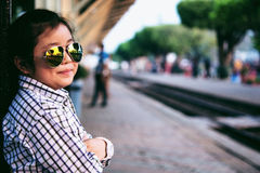 Cute girl in train station waiting to travel. Summer holiday. Stock Images