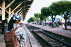 Cute girl in train station waiting to travel. Summer holiday. Stock Image
