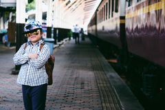 Cute girl in train station waiting to travel. Summer holiday. Royalty Free Stock Photography