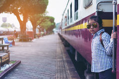 Cute girl in train station waiting to travel. Summer holiday. Stock Photography